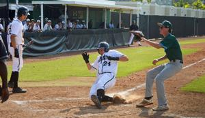 Kevin Martin sliding in safely with Lucas Costello watching