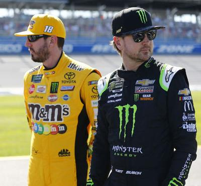 From left: Kyle Busch (18) and Kurt Busch (1) before  qualifying for the GEICO 500 at Talladega Superspeedway in Talladega, Alabama.