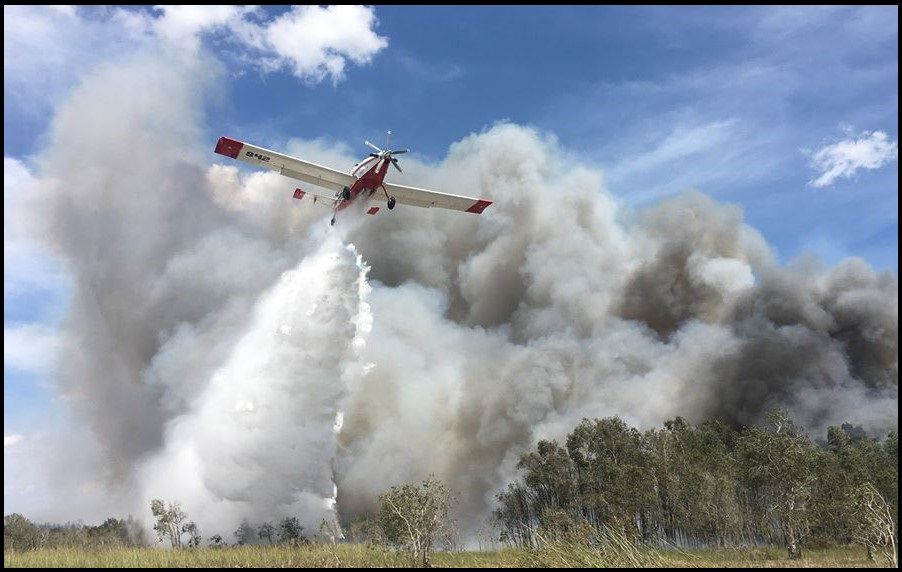 A Single Engine Airtanker aids in fire suppression as it drops water on the Sunday Afternoon Wildfire.