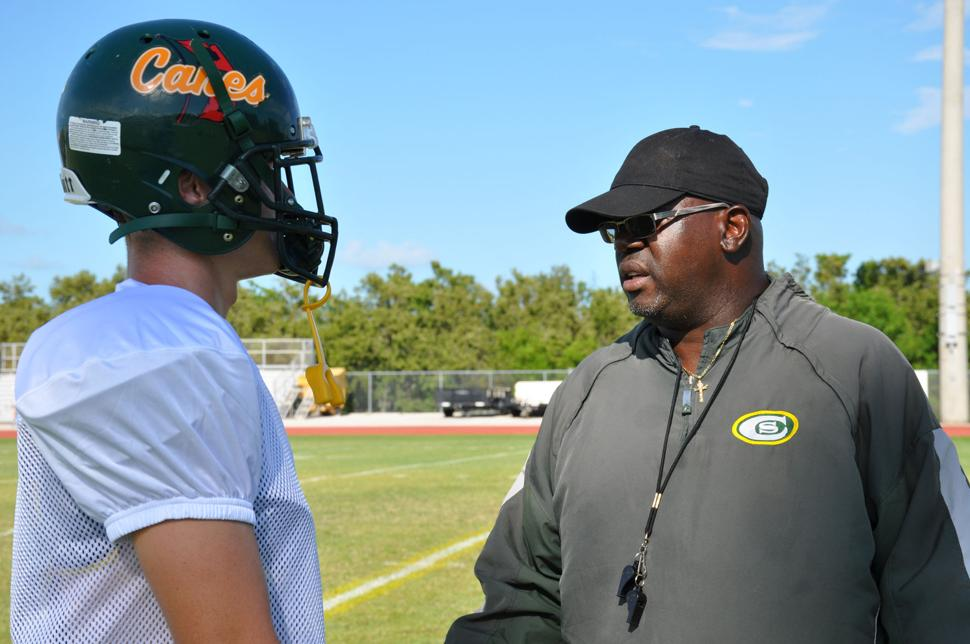 Coach Alphonso Bryant working with player at Coral Shores practice