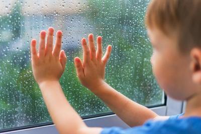 Boy at the rainy window