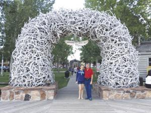 Michelle and Phil in Jackson Hole. Arch is made of elk horns collected by the boyscouts. This is one of 4 arches in the downtown center.