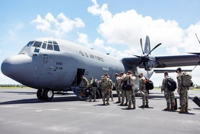 Haiti command and control element boards a C-130 aircraft from Homestead Air Reserve base to direct disaster relief operation in Haiti, Aug. 17.