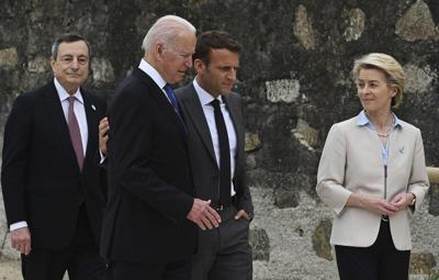 From left, Italian Prime Minister Mario Draghi, US President Joe Biden, President of France, Emmanuel Macron and European Commission Ursula von der Leyen speak after posing for photos for the Leaders official welcome and group photo session, during the G7 Summit, in Carbis Bay, Cornwall, England, Friday, June 11, 2021.