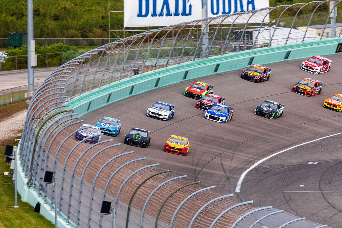 Practically four wide heading through Turn 4.