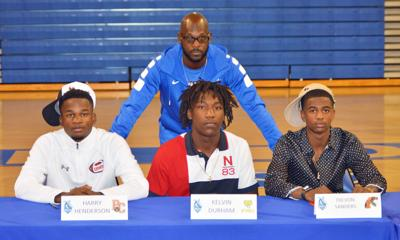 South Dade Head Coach Nate Hudson with (from left) Harry Henderson, Kelvin Durham and Trevon Sanders.
