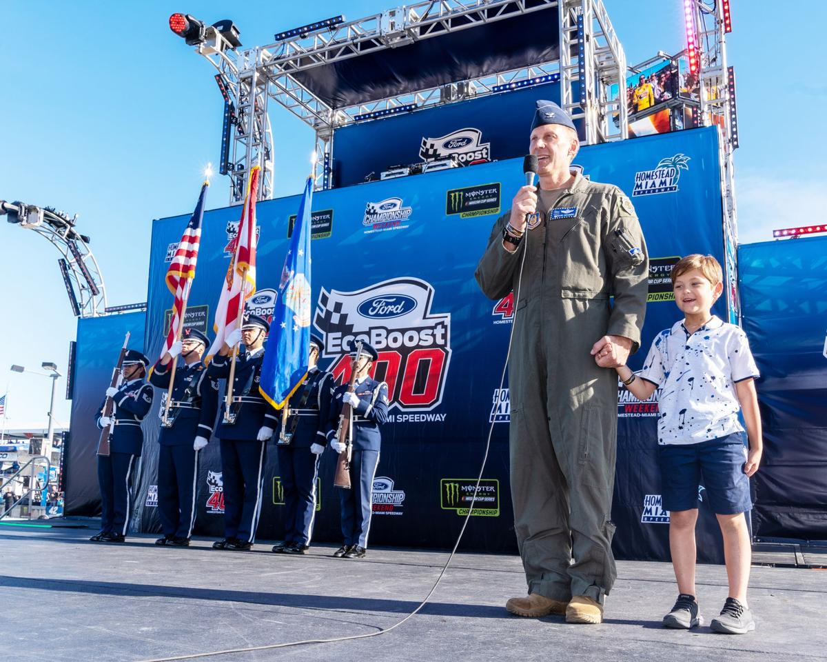 Colonel David Piffarerio, Commander, 482d Fighter Wing, HARB took the stage with his son Bryce to lead the Pledge of Allegiance, on November 2019 at the NASCAR Championship,  Homestead-Miami Speedway.