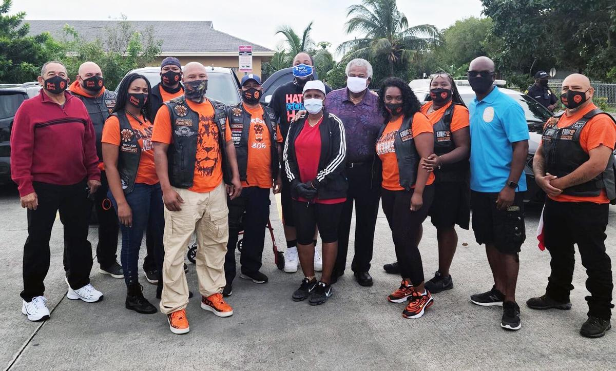 Black Lions  Homestead Motorcycle Club pose with Florida City Mayor Otis Wallace,  Florida City Vice Mayor Sharon Butler, and  Commissioner Kionnee McGhee.