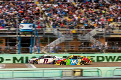 Denny Hamlin racing tight with Kyle Busch in November at Homestead-Miami Speedway.