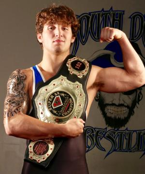 South Dade's Brevin Balmeceda with his championship Super 32 National Challenge belt.