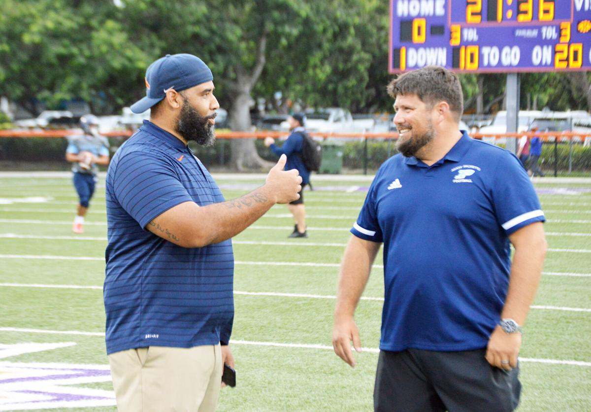 Homestead Coach Philip Simpson and Palmetto Coach Mike Manasco.