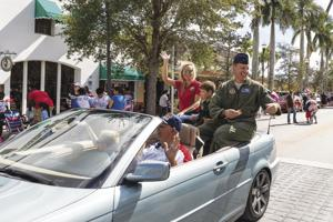 Grand Marshall for the day was Colonel David Piffarerio, the 482nd Fighter Wing Commander at Homestead Air Reserve Base.  He rode in the parade with his son Bryce, and State Rep. Holly Raschein.