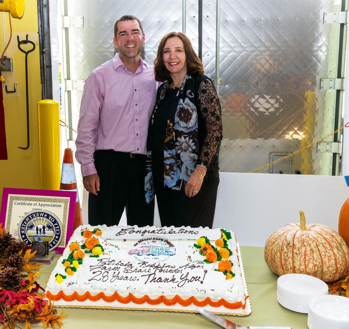 Patricia Robbins, founder and recently retired Farm Share CEO, with current CEO and Homestead Mayor Stephen Shelley, before cutting the cake made in her honor.