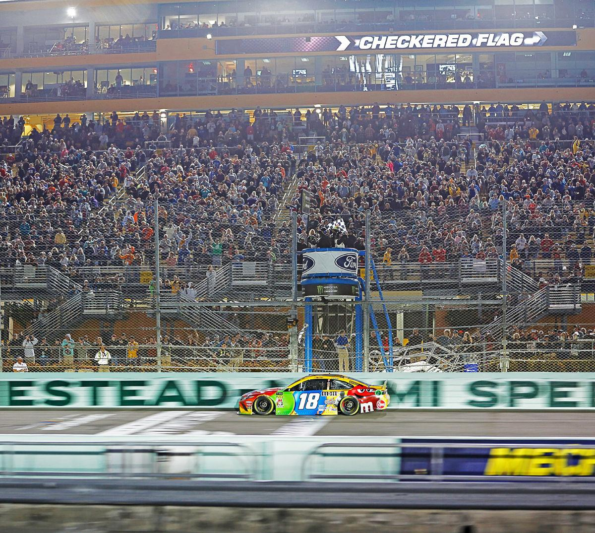 Kyle Busch takes the checkered flag, winning the Ford Eco Boost 400 and his 2nd series championship on Sunday  at Homestead-Miami Speedway