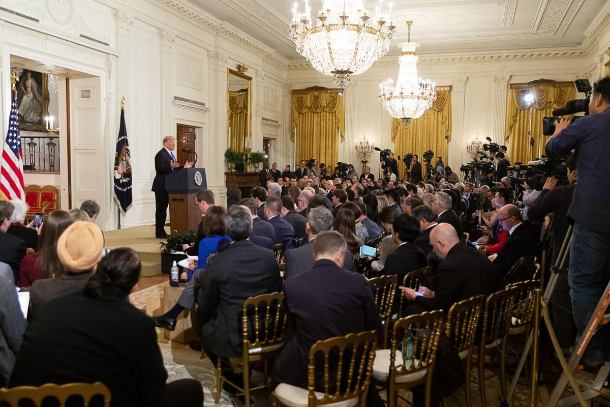 President Donald Trump holds a news conference.