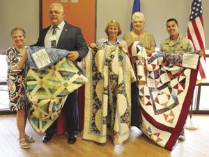 These large quilts require hundreds of hours each to complete. From left: Joyce Cotner,  David Cinalli, Carol Archangel, Charlotte DeOgburn, and Giovanni Gonzalez.