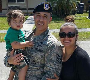 Tech Sgt Jose Rosado with Janelly Rivera and her son