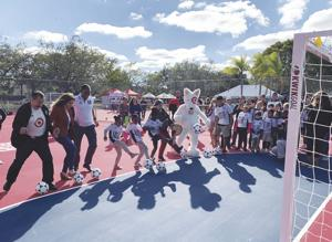 "Kids and officials ""Kick Off"" new South Dade Park Mini-Pitches."