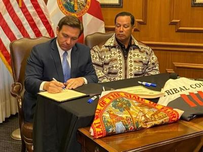 Gov. Ron DeSantis and Seminole Tribe Chairman Marcellus Osceola Jr. signed a gambling agreement in April.  NSF