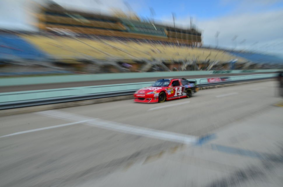 Tony Stewart drives down the pits during practice for the Ford 400 at Homestead-Miami Speedway in 2013.