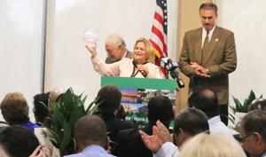 Congresswoman Ileana Ros-Lehtinen is presented with a crystal bowl to honor her years of service to the community.  With her are Rene Infante, chairman of the EDC of South Dade and Ron Magill of Zoo Miami..