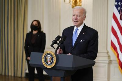 President Joe Biden, accompanied by Vice President Kamala Harris, speaks about efforts to combat COVID-19, in the State Dining Room of the White House.