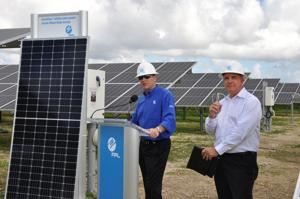 FPL President and CEO Eric Silagy with Miami-Dade Mayor Carlos Gimenez speak to the impact of the solar farm being constructed in the Redland.