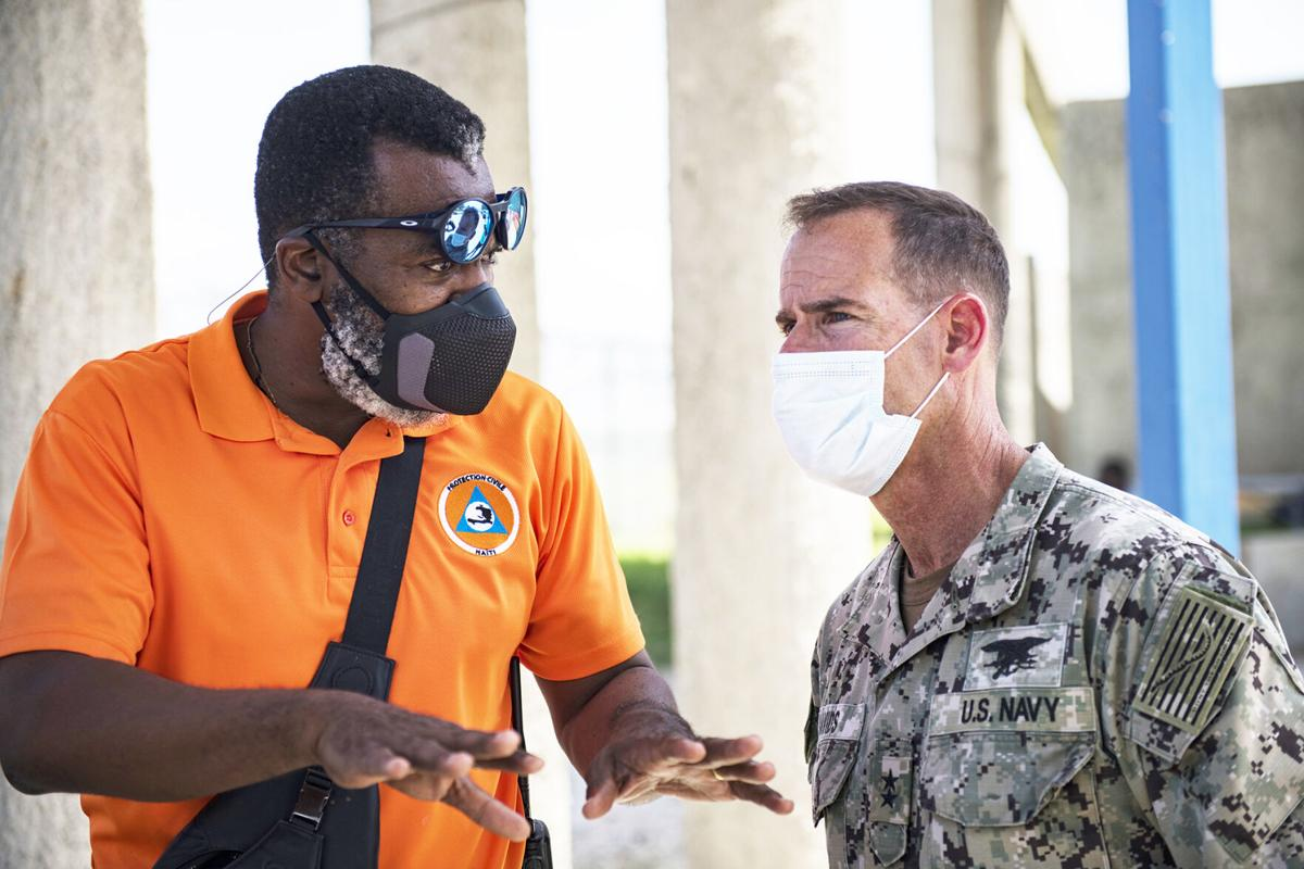 U.S. Navy Rear Adm. Keith Davids, right, U.S. Southern Command (USSOUTHCOM) Joint Task Force-Haiti commander, and Dr. Jerry Chandler, left,  Director General at Direction Generale de la Protection Civile, discuss support at Port-au-Prince, Haiti, Aug. 21, 2021. U.S. Agency for International Development is the lead U.S. federal agency for foreign disaster assistance and USSOUTHCOM is supporting relief efforts.  Photo: Tech. Sgt. Marleah Cabano