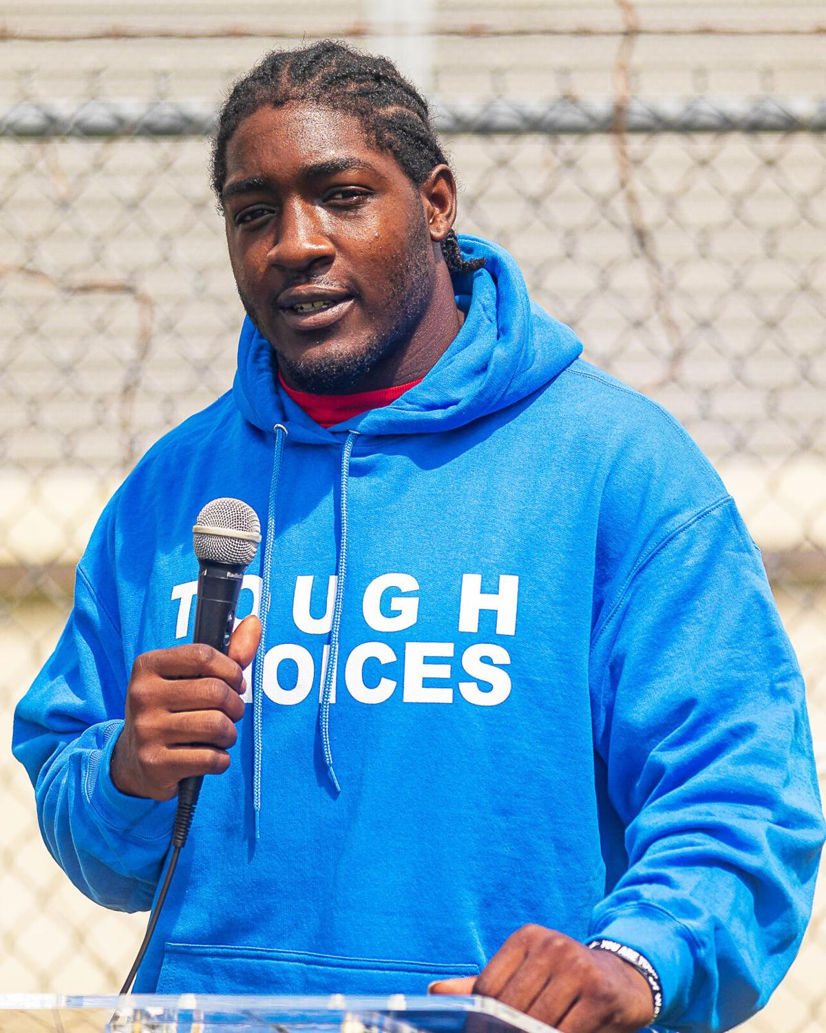 Tevon Coney, former NFL player and founder of Tough Choices Foundation, speaks briefly to the students before their breakout session.