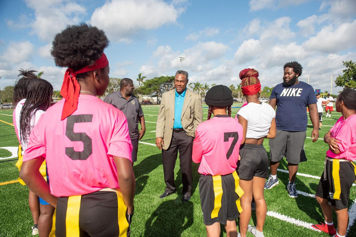 Flag football participants with Miami Dolphins' Nat Moore.