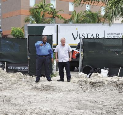 Florida City Mayor Otis Wallace and Vice Mayor R.S. Shiver survey the construction of the newest of Florida City's hotels.