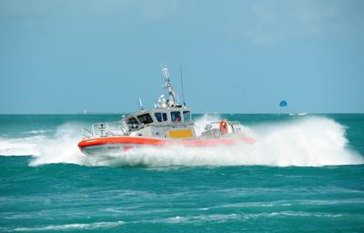 The crew of a Coast Guard Station Key West 45-foot Response Boat-Medium performs a tactical maneuver.