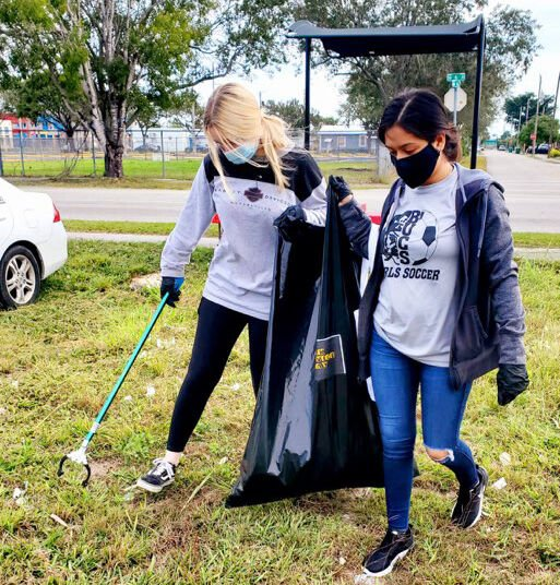 South Dade High School students picking up litter near the block of 14 Street NW 6 Avenue.