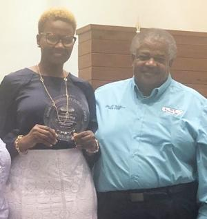 Teacher of the Year Katina Perry-Birts was honored during a Florida City Commission meeting.  Katina is  pictured here with Florida City  Mayor Otis Wallace.