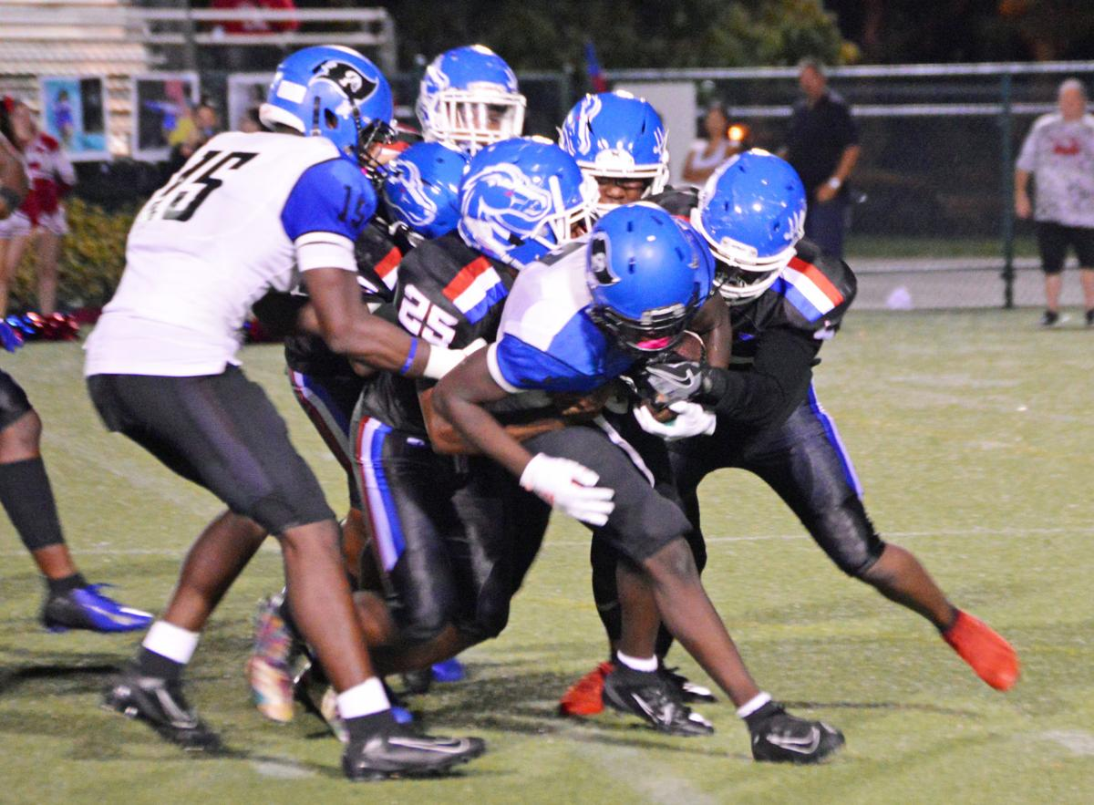 South Dade's Willie Thomas carries a few players with him.