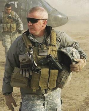 General Sean Mulholland, pictured left, during a  deployment in the Middle East, passed away on August 8, 2018.   General Mullholland served as commander of SOCSOUTH from Oct 2012 to August 2014.