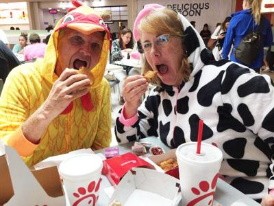 Phil and Patty Marraccini get into the spirit of Cow Appreciation Day to support Chick-fil-A.