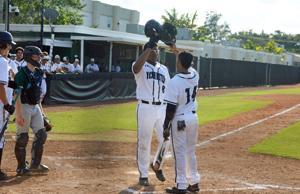 Jamar Fairweather celebrating his home run with Jayden Melendez (14)