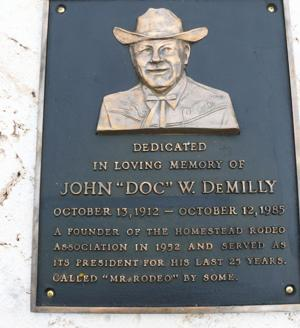 """In  1989 the Homestead Rodeo Association dedicated a  memorial monument to the late John """"Doc"""" W.  DeMilly."""