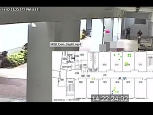 """Video shown at commission meeting of Peterson failing to enter the """"1200 building"""" as a deadly hail of bullets rained down on students. The video was overlaid with animation of the massacre that depicted alleged shooter Nicholas Cruz, a former Stoneman Douglas student, with a black dot, while students and faculty were portrayed by green dots that turned gray after they were shot and killed."""