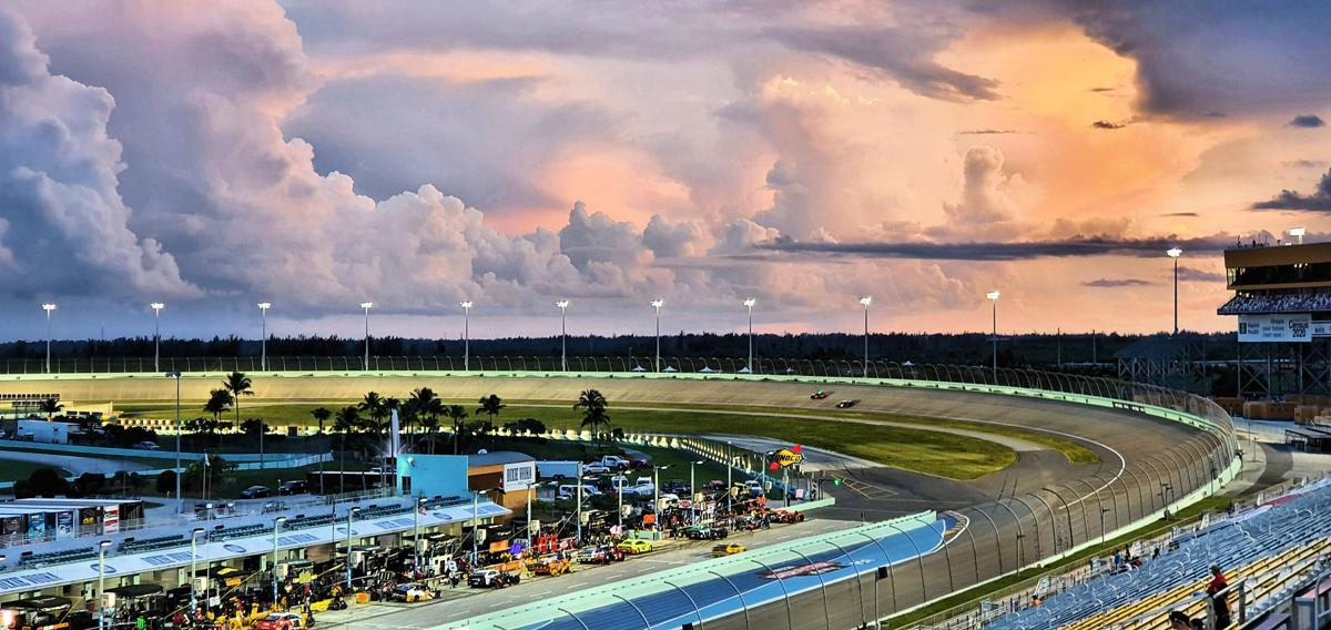 1,000 special military guests enjoy the racing at twilight during the Dixie 400.