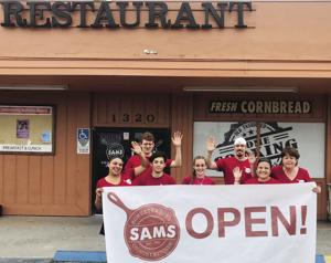 The owner's and employees of Sam's County Kitchen on Krome Ave.