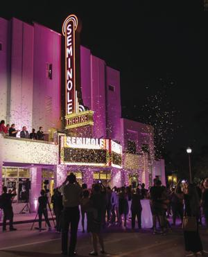 The bright lights of the Seminole Theaters new marquee lit up the night.