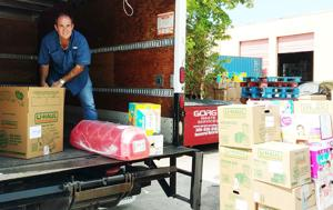 Steve Lossner loading a truck being filled by Homestead Rotary with supplies for Irma relief in Dominica