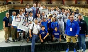 The South Dade Wrestling Team celebrates a fantastic showing at the state championships, supported by Principal Javi Perez (front, blue).