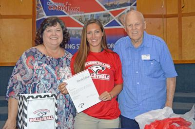 Jessica Givens on signing day, with her mother and grandfather.