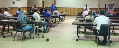 Commissioner Kionnee McGhee met with area farmers to discuss their concerns.