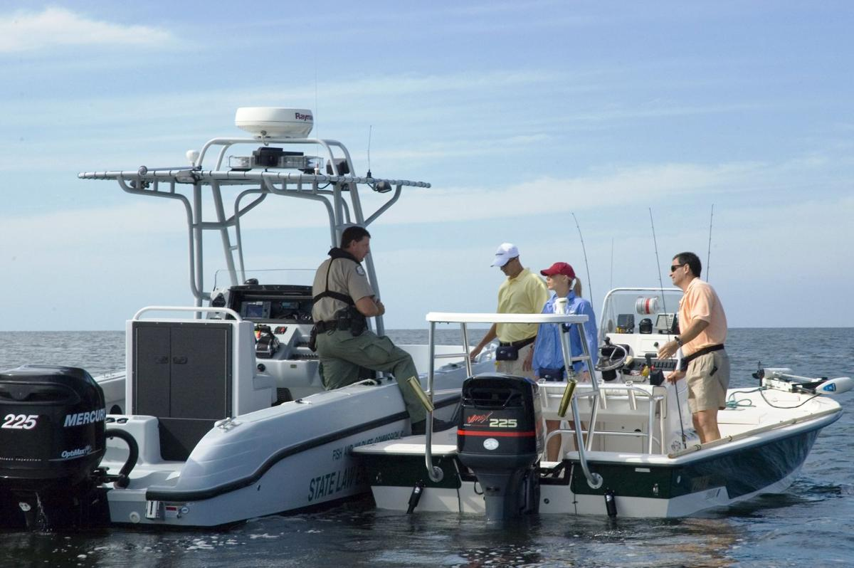 Law Enforcement performs a vessel safety check .
