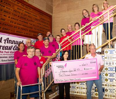 Members of American Legion Post 43 look forward to the presentation check to the Susan B. Komen Foundation.