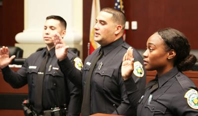 Homestead's new reserve officers (from left) Bryant Escalante, Yadiel Rodriguez,  and Latrice Milton.